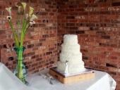 coconut-covered-wedding-cake-full-screen